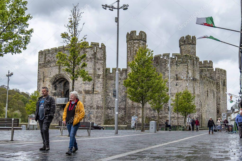 Caernarfon Wales - May 01 2018 : Caernarfon on a windy day in the rain
