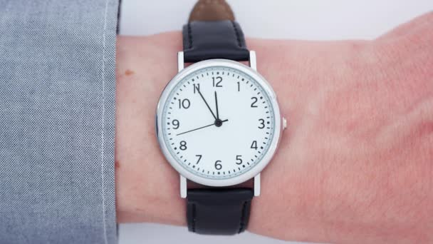 Close up time-lapse of a wrist watch on a Caucasian man`s wrist