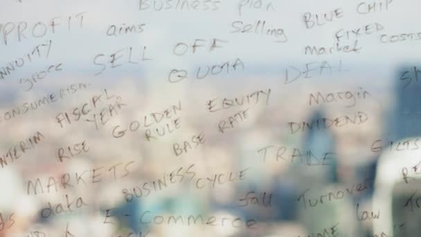 Reflection of a creative businessman brainstorming writing business  keywords onto glass london skyline behind