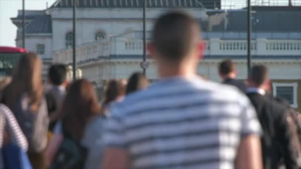 LONDON / ENGLAND - CIRCA April 2018: Defocussed slow motion of pedestrians at rush hour on london bridge. Rush hour is a part of the day during which traffic congestion on roads and crowding on public transport is at its highest.
