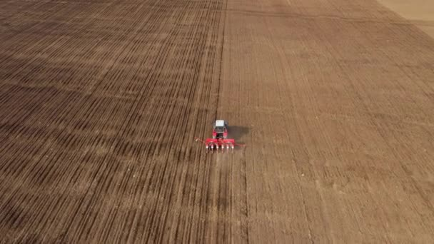 Aerial view of ploughed field with tractor