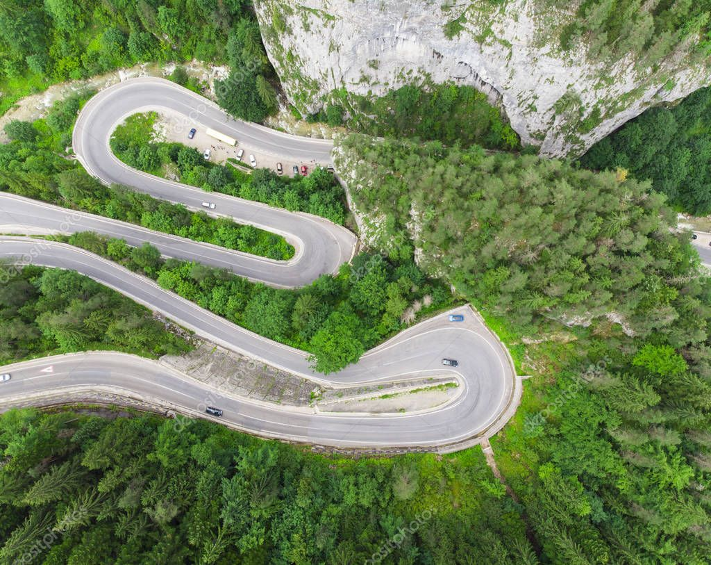 curved road with cars and beautiful forest landscape. Bicaz gorges, Romania. Aerial view from drone