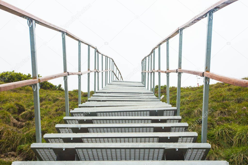 ladder or stairchase in the mountain. white background