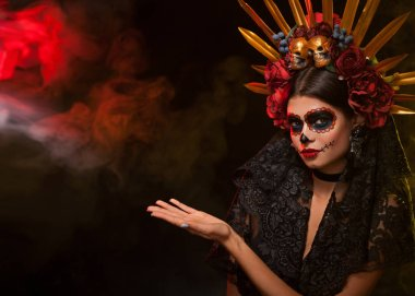 Creative image of Sugar Skull. Neon makeup for Halloween or Dia De Mertos holiday.