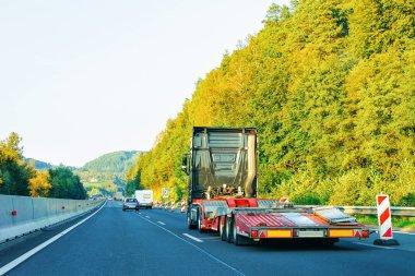 Empty carrier truck on the highway asphalt road in Poland. Truck transporter