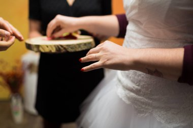 close-up of bride taking wedding ring during wedding ceremony