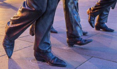 LIVERPOOL, UK - JULY 29TH 2018: A close-up of the Beatles boots on The Beatles statues in Liverpool, on 29th July 2018.