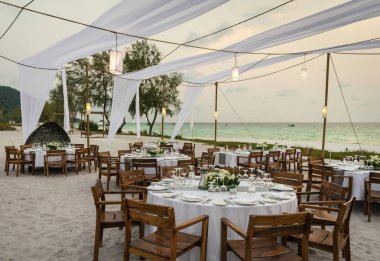 romantic wedding table design at sunset outside on asian beach