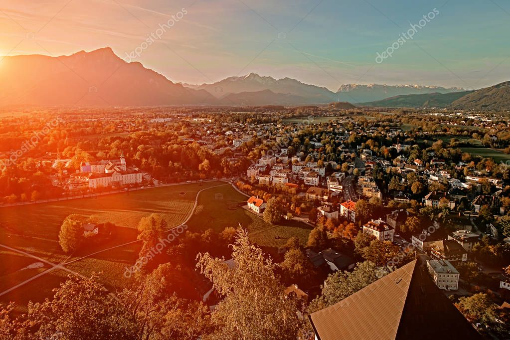 Beautiful sunset aerial view on Salzburg, Austria, Europe. City in Alps of Mozart birth. Panoramic view of Salzburg skyline from Festung Hohensalzburg in autumn.