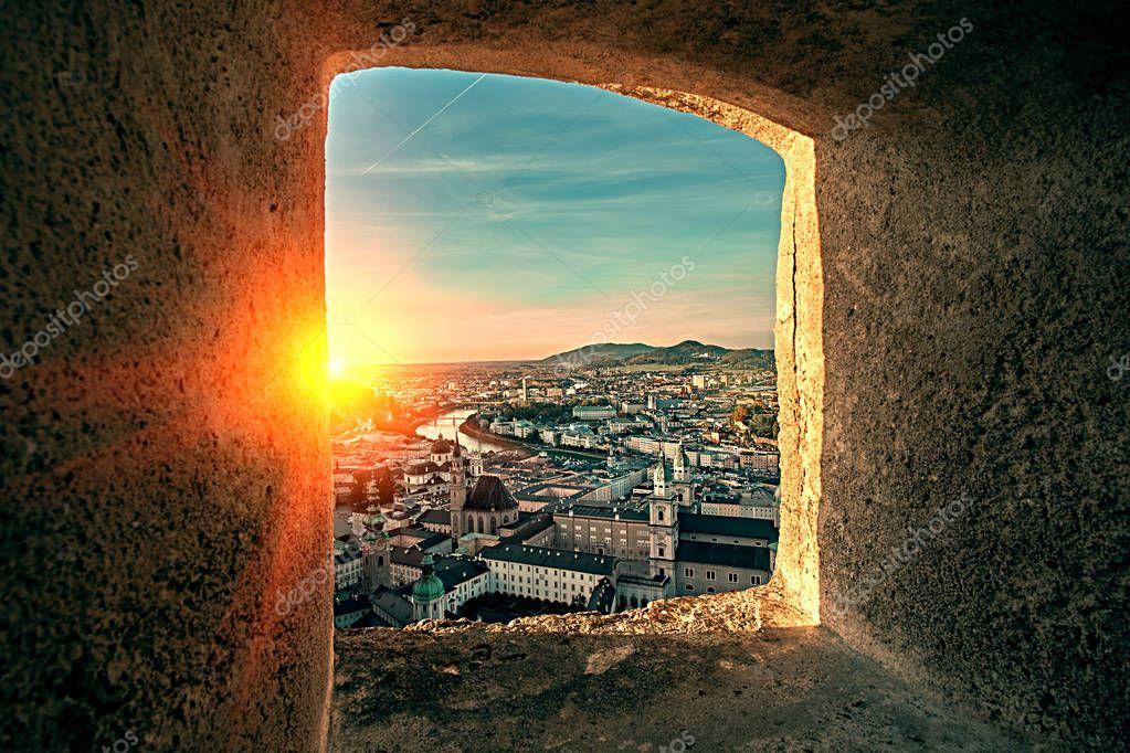 Beautiful sunset aerial view on Salzburg, Austria, Europe. City in Alps of Mozart birth. View of Salzburg skyline from Festung Hohensalzburg castle fortress window