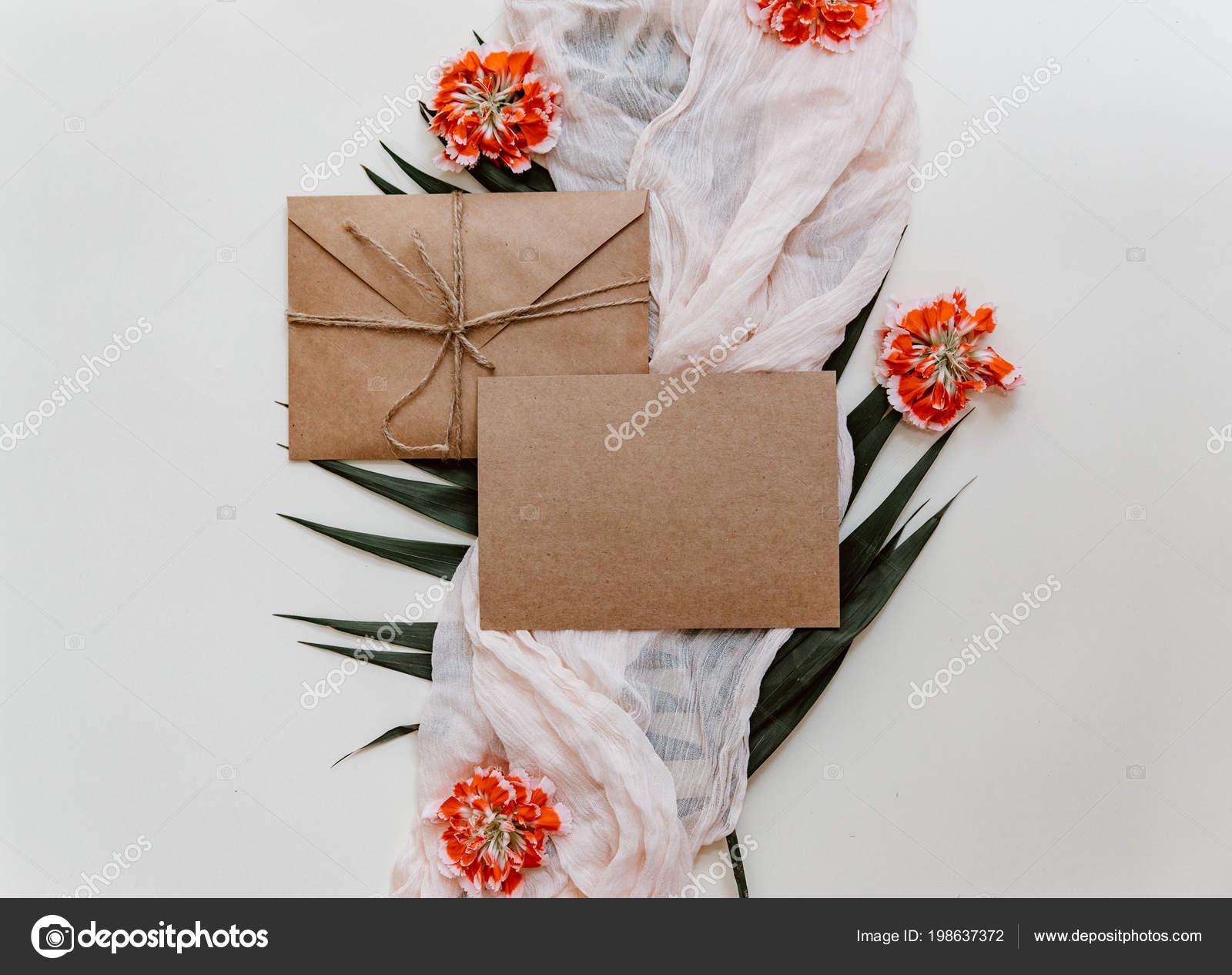 Wedding invitation card greetings card craft envelope flowers flat wedding invitation card greetings card craft envelope flowers flat lay fotografia de stock stopboris Choice Image