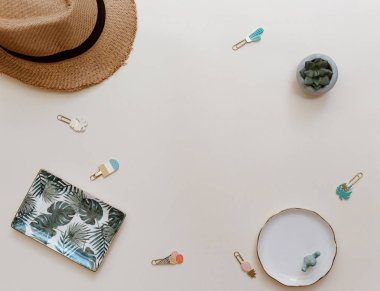 Flat lay summer composition. Creative concept straw hat and invitation card. Top view, copy space