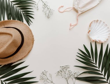 Flat lay summer composition. Creative concept tropical leaves and straw hat . Top view, copy space