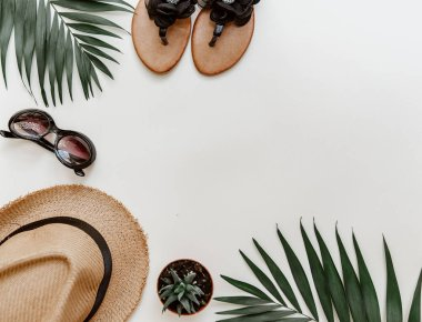 Flat lay summer composition. Creative concept tropical leaves and summer accessories. Top view, copy space