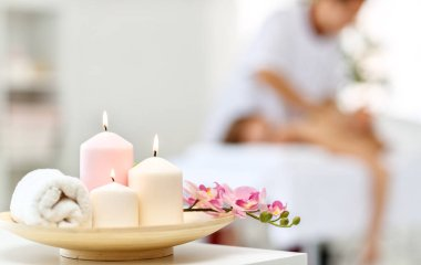 composition of spa candles and white towel
