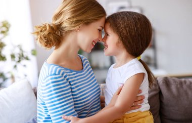 happy mother's day! a child daughter   hugs and congratulates mother