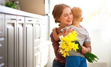 happy mother's day! child son gives flowersfor  mother on holida