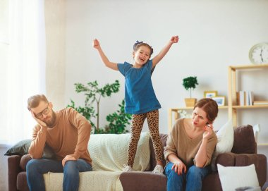 naughty, mischievous, child girl jumping, laughing and having fu