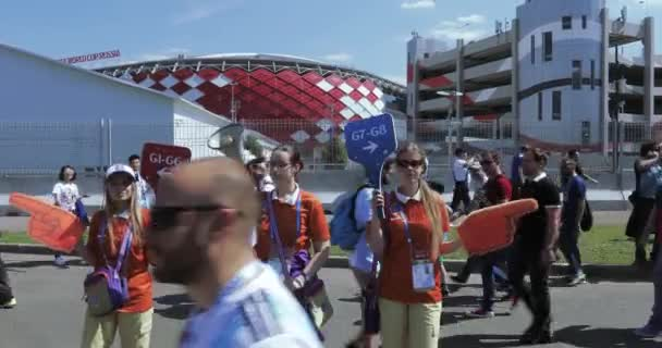 Volunteers in front of football