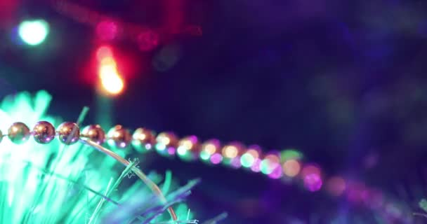 Toys hang on the Christmas tree and the New Year illumination burns on the background