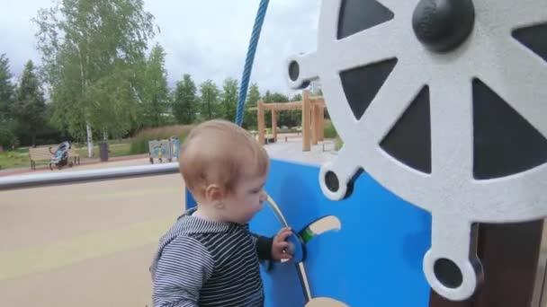 Child turns the steering wheel