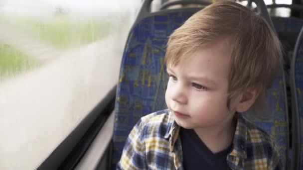Boy in seat in bus