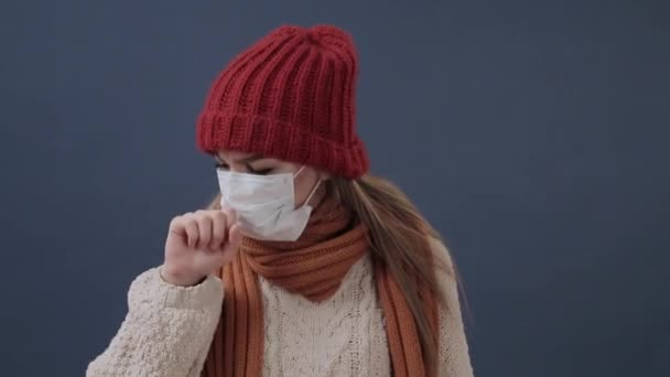 Sick girl puts on a mask coughs and sad
