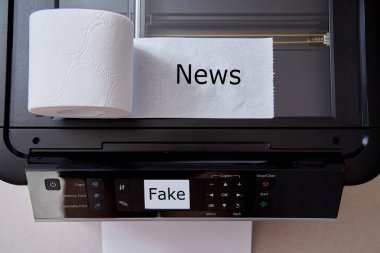 Fake news, disinformation or false information and propaganda concept. A roll of toilet paper, and a printer. stock vector