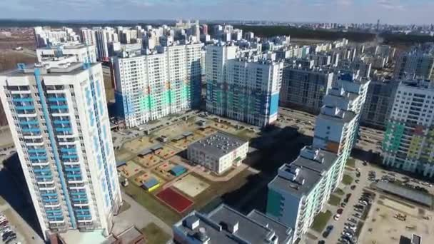 Top view of a modern residential complex with new buildings. Footage. Complex of modern apartment residential buildings with children playground as outdoor facilities