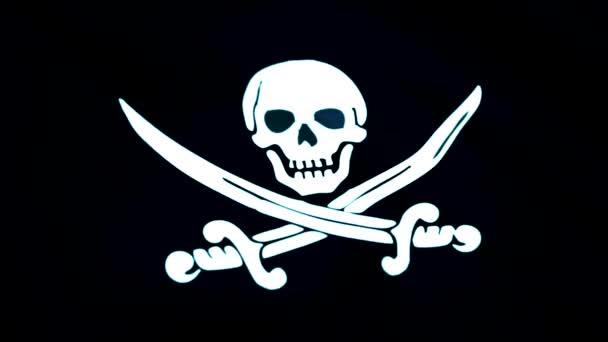 Animace z pirátské vlajky closeup. Jolly Roger je tradiční anglický název pro nosti k identifikaci pirátské lodi chystají zaútočit. Pirátská vlajka zpomalené smyčka