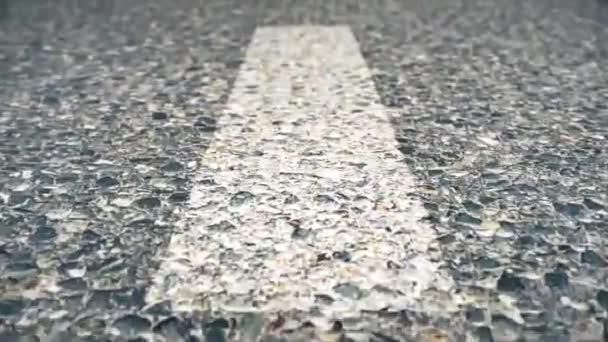 Line On The Road, Close-up, Fast movement. Speed road flight, seamlessly loop-able. Close up of road, asphalt, white arrow signs indicating direction, way, of the highway. Urban traffic flow, pulse.