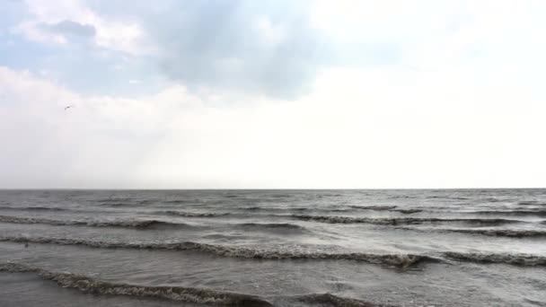 Sea waves with sun and blue sky. Azure calm sea with orange beach and cloudy blue sky. Low angle, wide view on straight front. beautiful waves in the sea. Video