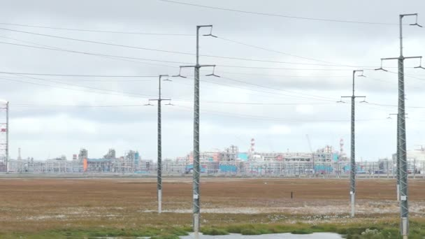 Transmission lines and factory background. Video. Oil and gas industry,refinery factory,petrochemical plant area. Electricity plant industry estate use as electrical power background