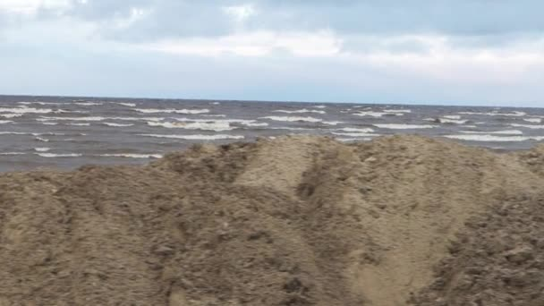 Beautiful beach, sea and footprints in sand. Wave of the sea on the sand beach. Video