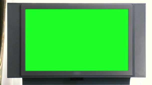 Green Screen régi Tv-irodai környezetben. Jelenet. Vintage hivatalban zöld Tv-képernyőn. Képernyő chroma-key