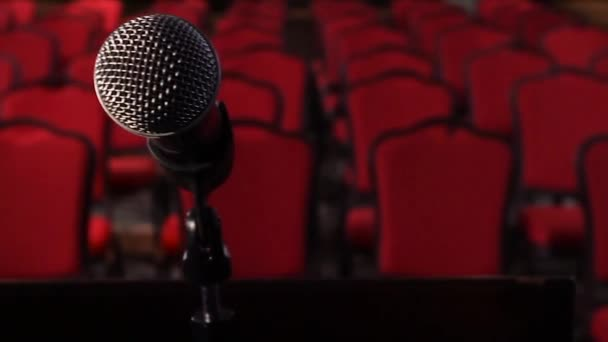 On an empty stage microphone in front of an empty hall. Scene. Microphone on stage close-up