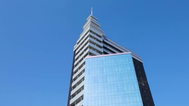 Modern office building with reflective glass. Scene. Modern skyscraper on blue sky background