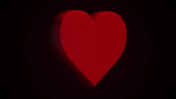 Animaci rotující červené srdce na černém pozadí. Pojetí lásky