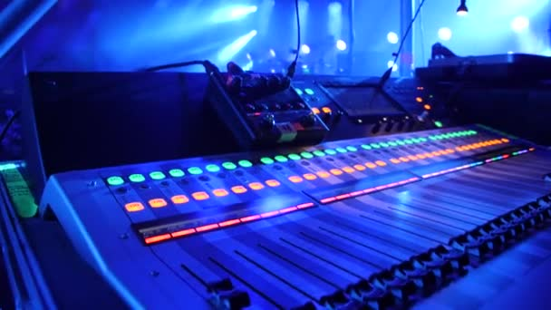 Close up of dj control panel playing party music on modern player in disco club. Nightlife and entertainment concept