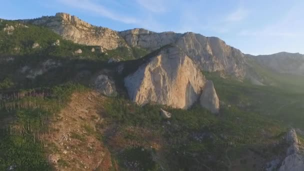 Beautiful summer landscape in the mountains. Shot. Panoramic scene of a rocky cliffs and green hills