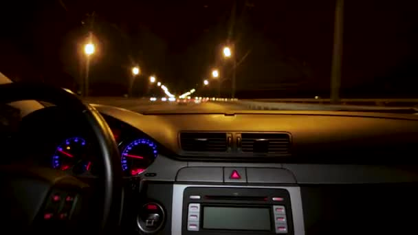 Car driving at night. Driving car in the city view from the interior. Timelapse of driving at night with camera in car