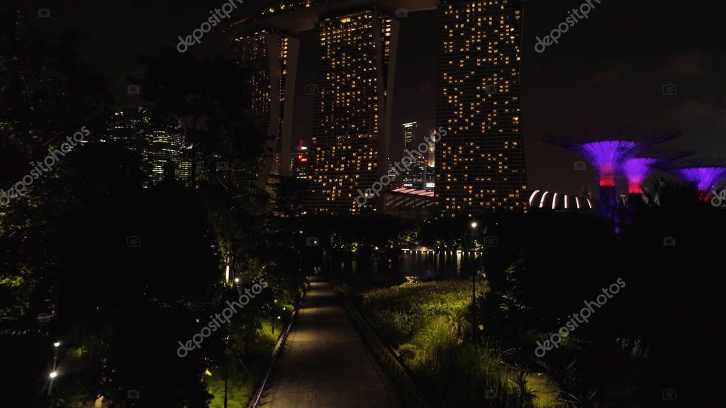 Top view of cityscape at Sand Sky Park Singapore at twilight time. Shot. Top view of Singapore in the evening