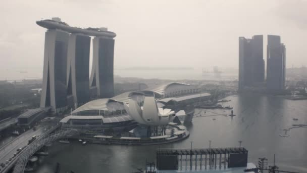 Timelapse Singapore Marina Bay with dark clouds and a view of the skyscrapers. Shot. Time lapse Singapore of the marina bay