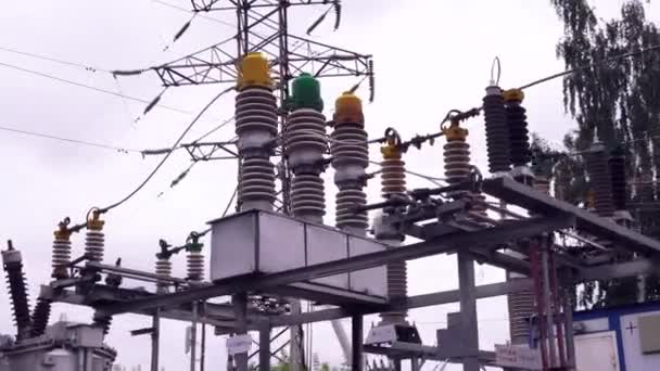 Power lines and electric poles. Frame. High-voltage lines against background of electrical distribution stations