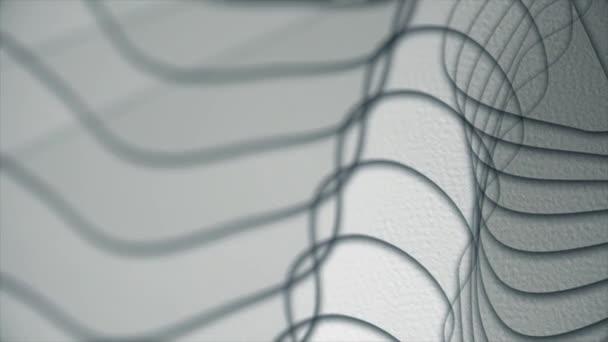 Plynoucí linie na šedém pozadí. Hladké vlny abstrakce.
