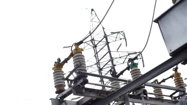 Electrical substation equipment: electricity transmission line, earthing switch. Frame. Earthing switch and a power line on sky background.