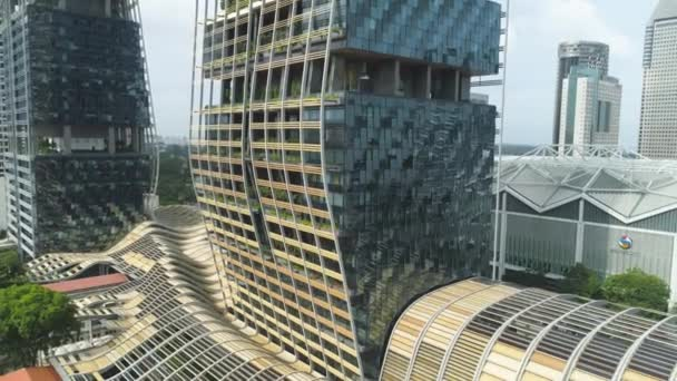 Singapore - 25 September 2018: Close up view for vertical forest building in the center of the city, nature saving concept. Shot. Modern, unusually designed building with many trees on the balconies