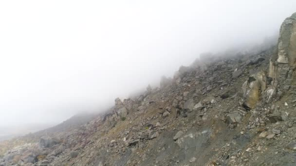 Majestical mountains in thick clouds. Shot. Landscape with beautiful rocks and dramatic fog, nature background.