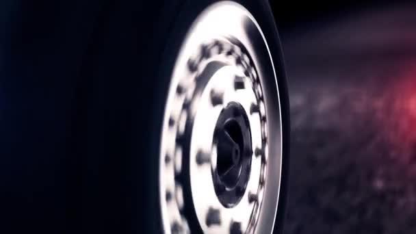 Boční pohled na abstraktní auto kola jízdy zpět na černé cestě. Zavírají se na kola automobilu s stříbrný disk přesunete abstraktní černé asfaltové silnici.