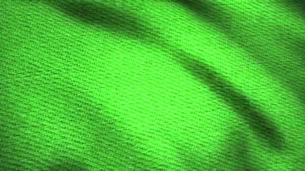 Denim tkanina texturou, zelené chvění. Animovaný pohyb plátna. Vlny materiálu